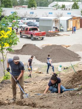Students and alumni work at Kenton Women's Village site
