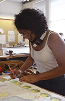 Architecture Summer Immersion Program student works on a drawing in studio.