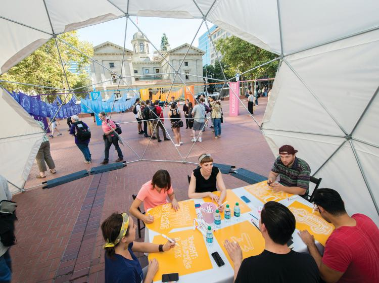 Graphic design students work on a project during a Design Week Portland event at Pioneer Courthouse Square