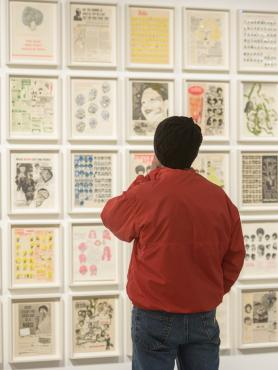 A Student looking at a wall of art