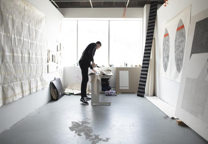 Graduate student working in his studio
