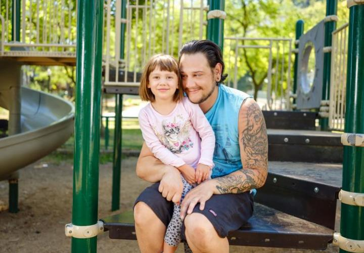 Jeff Martinez with his child at a playground