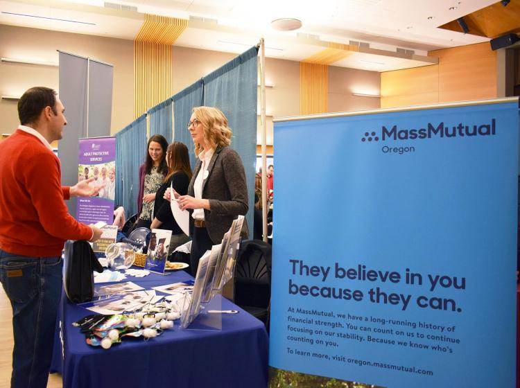 Mass Mutual Recruiter talking with interested students