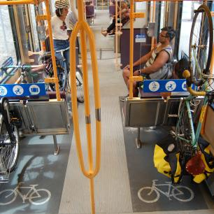 Bicycles hang on bike racks on a TriMet MAX train