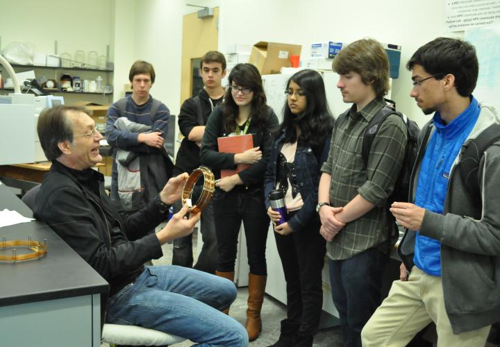 a professor lecturing to a group of students