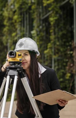 Engineering student using plane surveying equipment