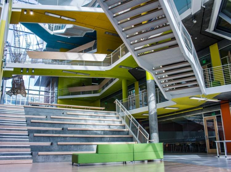 Architectural features of the Karl Miller Center, showing the intersection of the stairs and different colors of each of the floors
