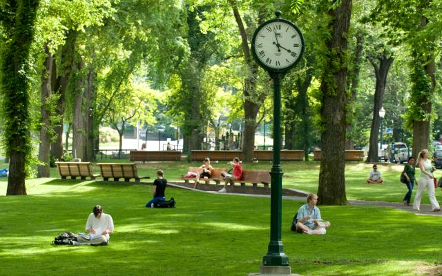 Students in park blocks with clock
