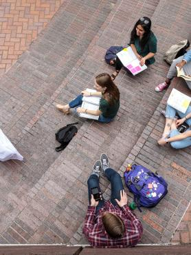 a group of Portland State University economics students studying in Urban Plaza
