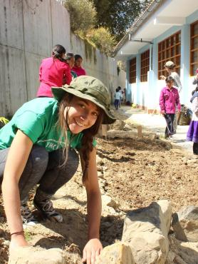 PSU student digging in the dirt in Peru
