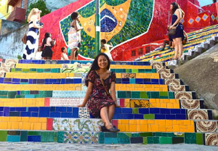 woman sitting on brightly colored steps