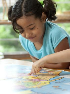 two young students of the PSU Early Childhood Education program studying a map