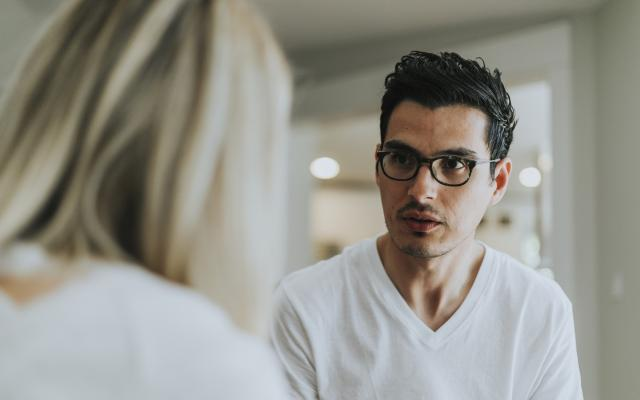 Bespectacled man receiving therapy