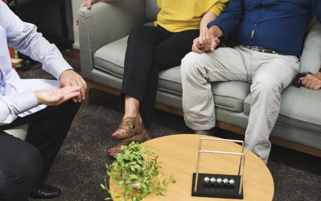 An older man and a woman receiving couple counseling