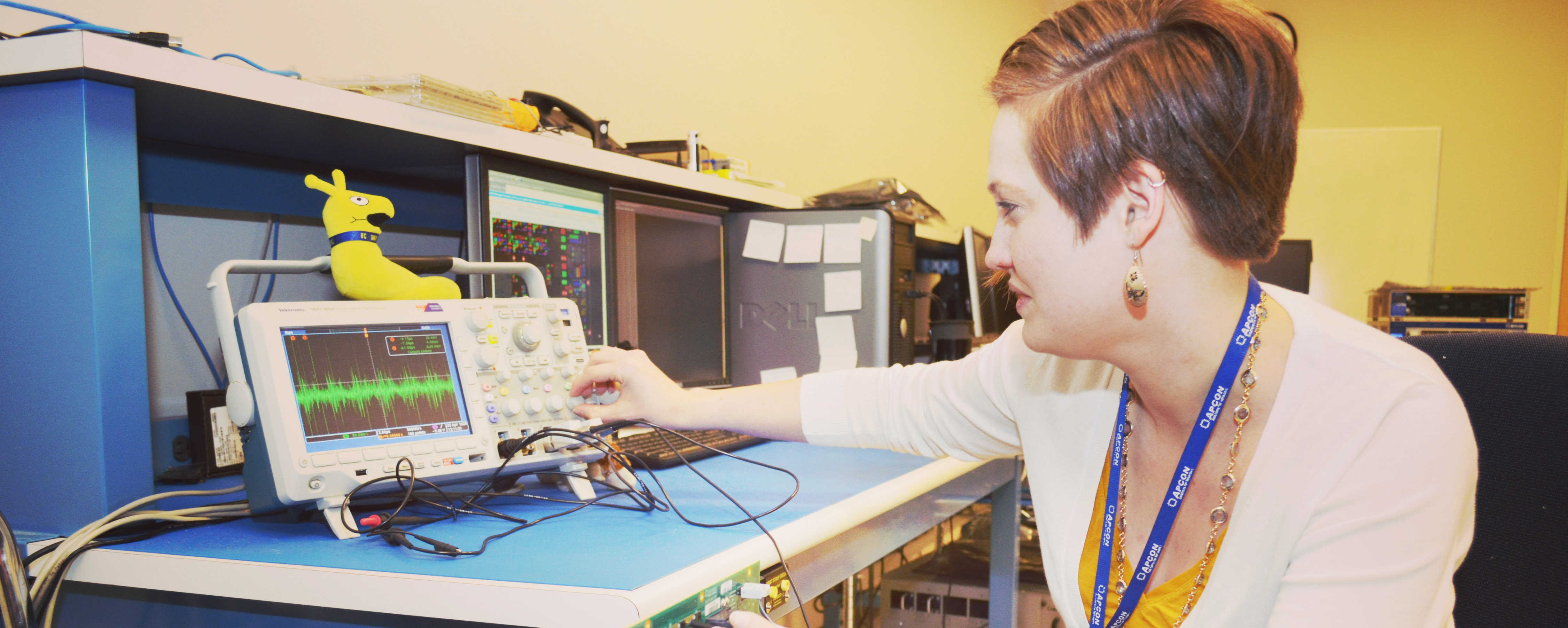 A student turning knobs on a computer