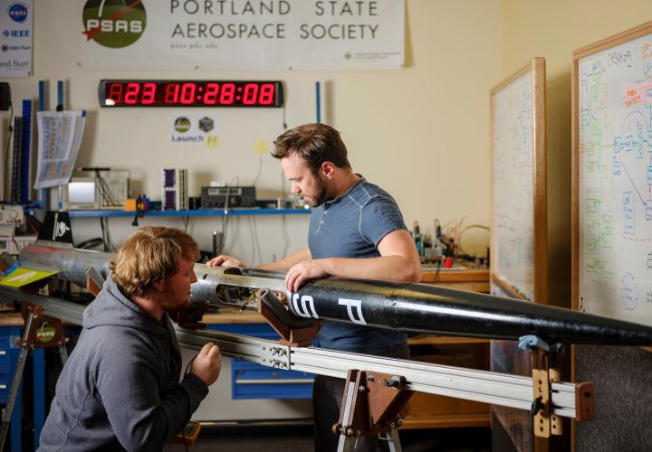 Portland State Aerospace Society students working on a rocket