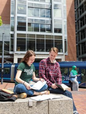 Students sitting together and studying outside on Portland State campus