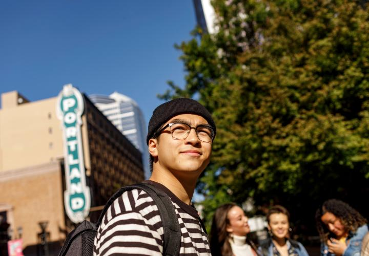 Student next to Portland sign