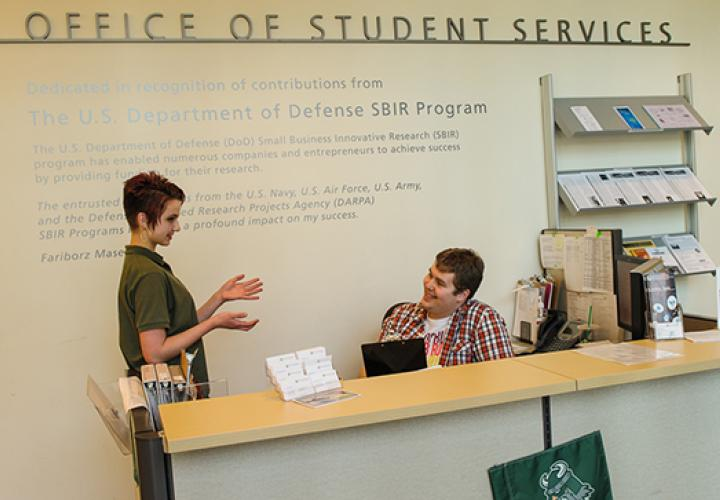 Students chatting in the Office of Student Services