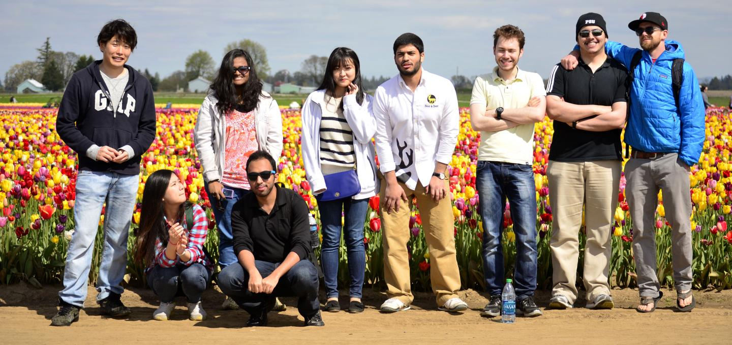 Students standing in front of tulip field