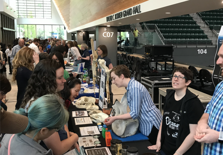 Students hosting a biology exhibit at an Ocean Sciences Event