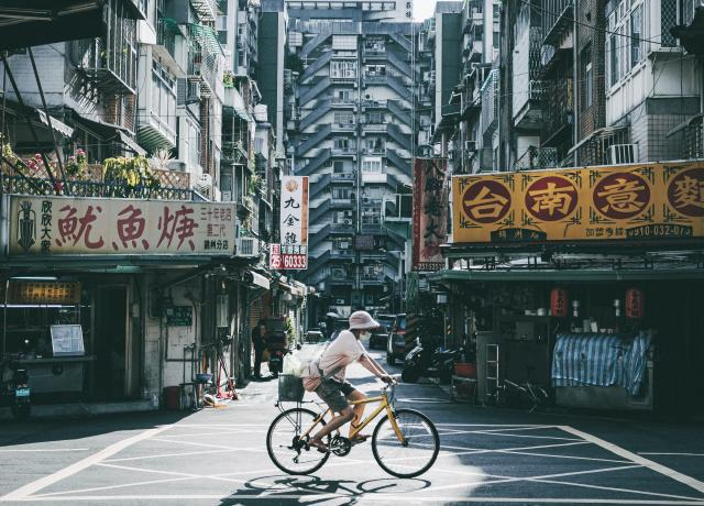 Man riding bike in Taiwan