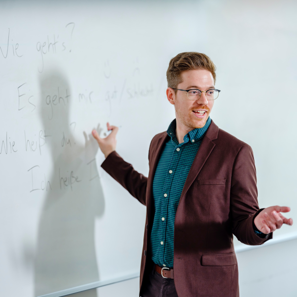 Photo of graduate professor in front of whiteboard
