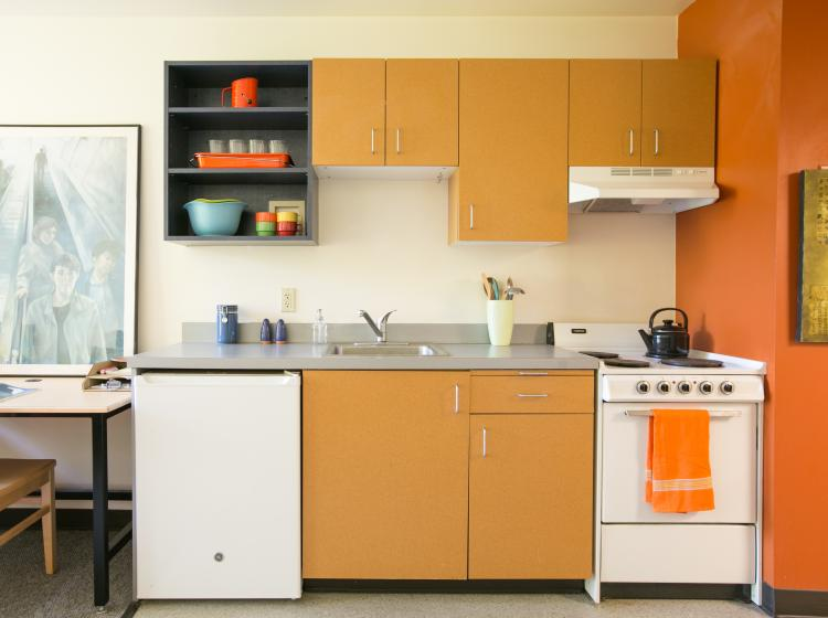 Kitchenette with mini fridge and stove with oven