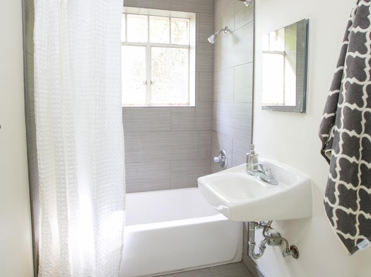 Bathroom with tub and shower in furnished quad