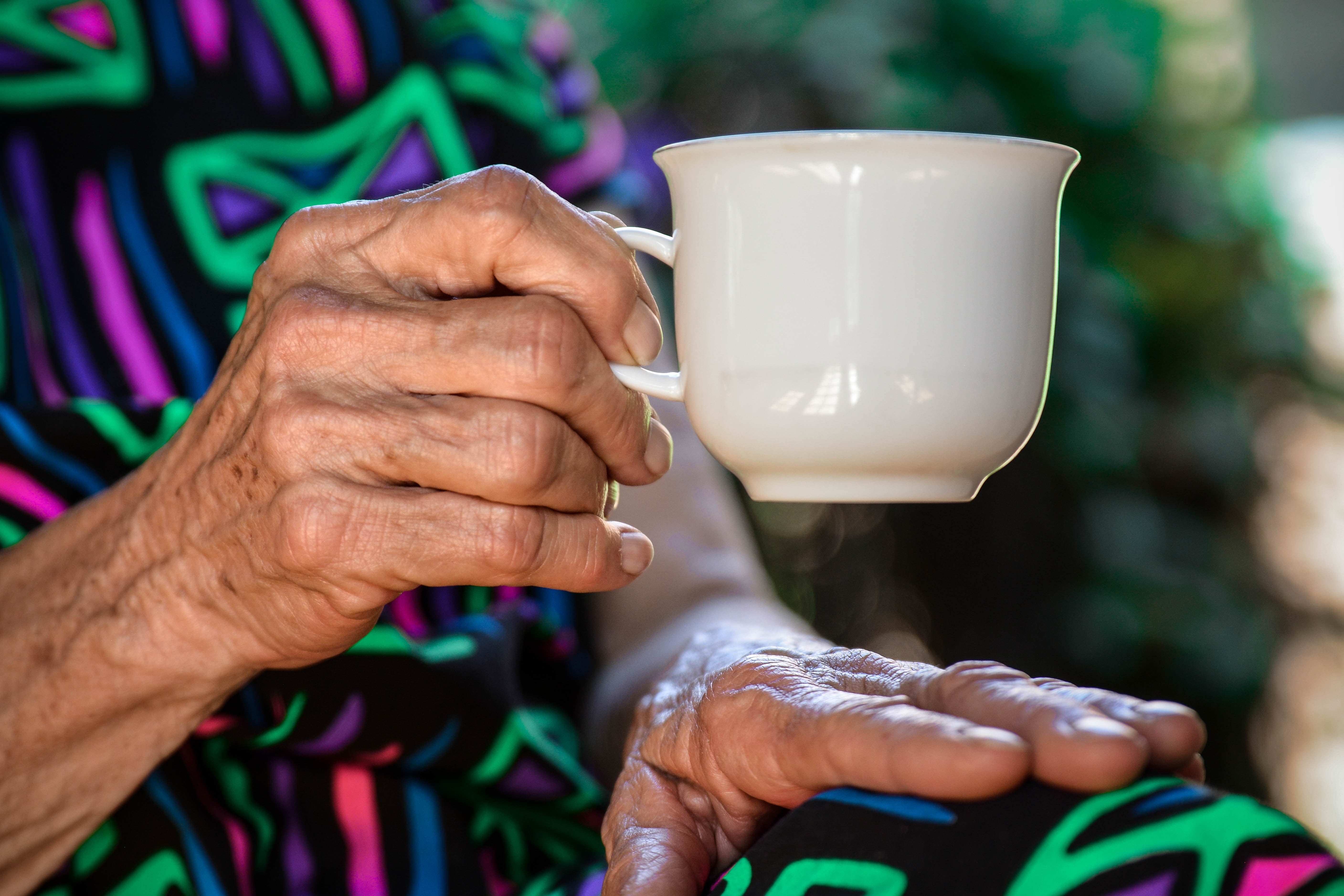 Older woman holding coffee cup