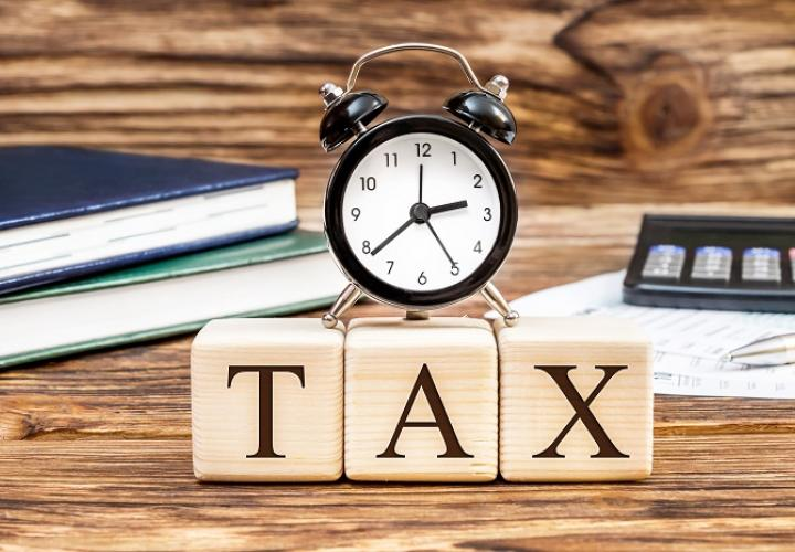 "Image of the word ""Tax"" with ticking clock"