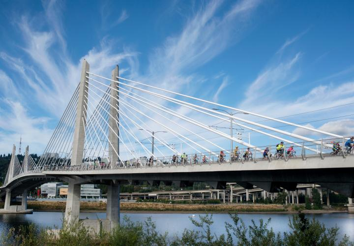 Portland's Tillikum bridge with many cyclists on it.