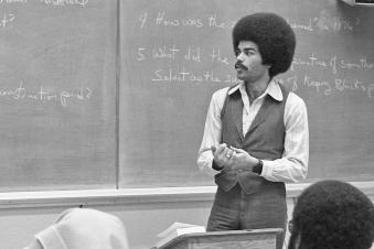 A professor in a classroom in the 1960s or 1970s