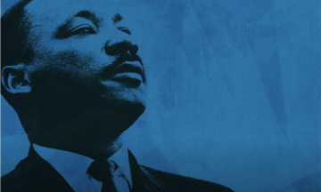 Photo of MLK against a blue background