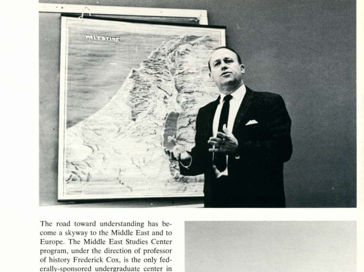 A clip from the Viking Yearbook from 1962 of MESC founder Fred Cox in front of a map.
