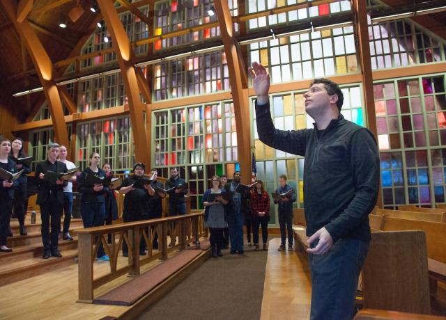Professor Ethan Sperry conducts PSU Chamber Choir