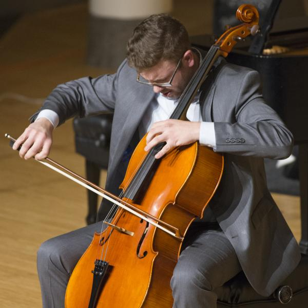 Cello student performing in recital
