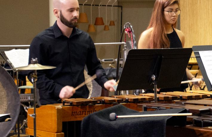 Percussion ensemble students performing