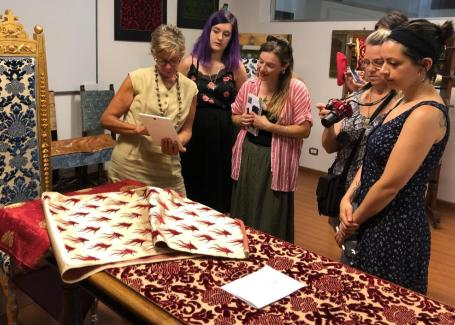 people looking at a piece of fabric and instructor