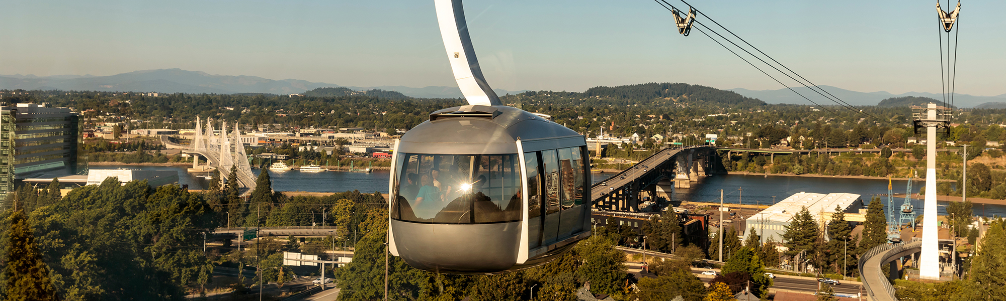 aerial view of the OHSU tram over the Portland skyline