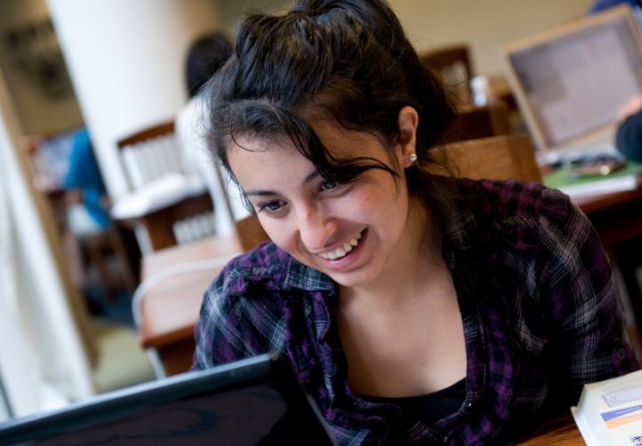Close-up of student looking at laptop in library