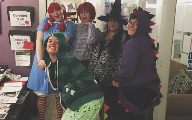 5 quer people dress up for halloween as Ragady Ann, Ragady Andy, 2 dinosaurs, and a witch