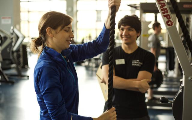 Personal trainer helping a client
