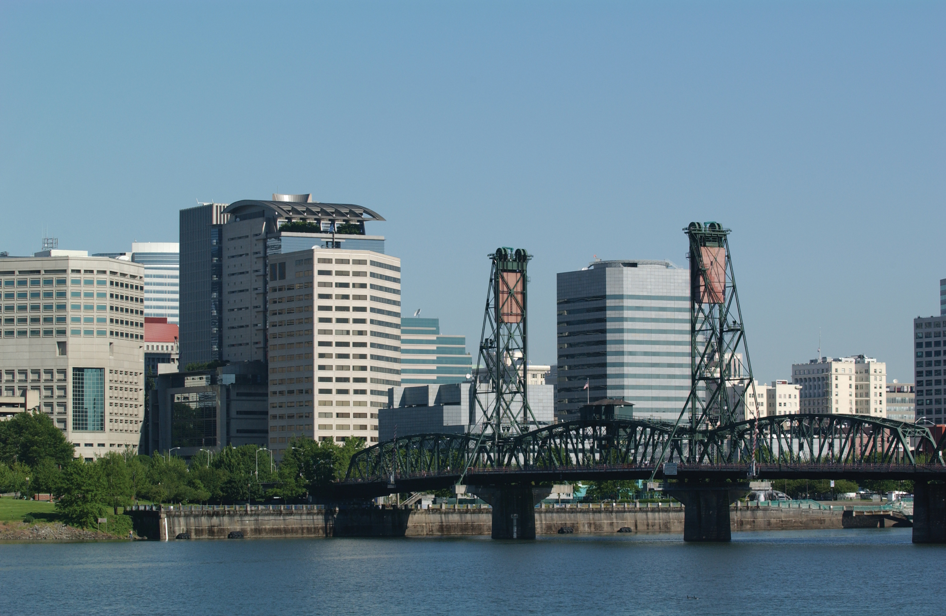 Portland skyline with Hawthorne Bridge and Willamette River in foreground