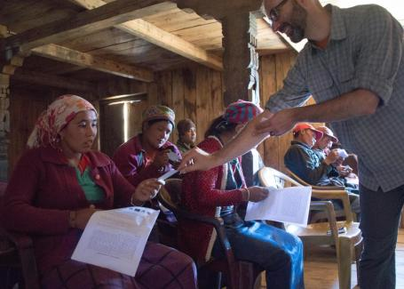 Jeremy Spoon, right, conducting surveys in Nepal