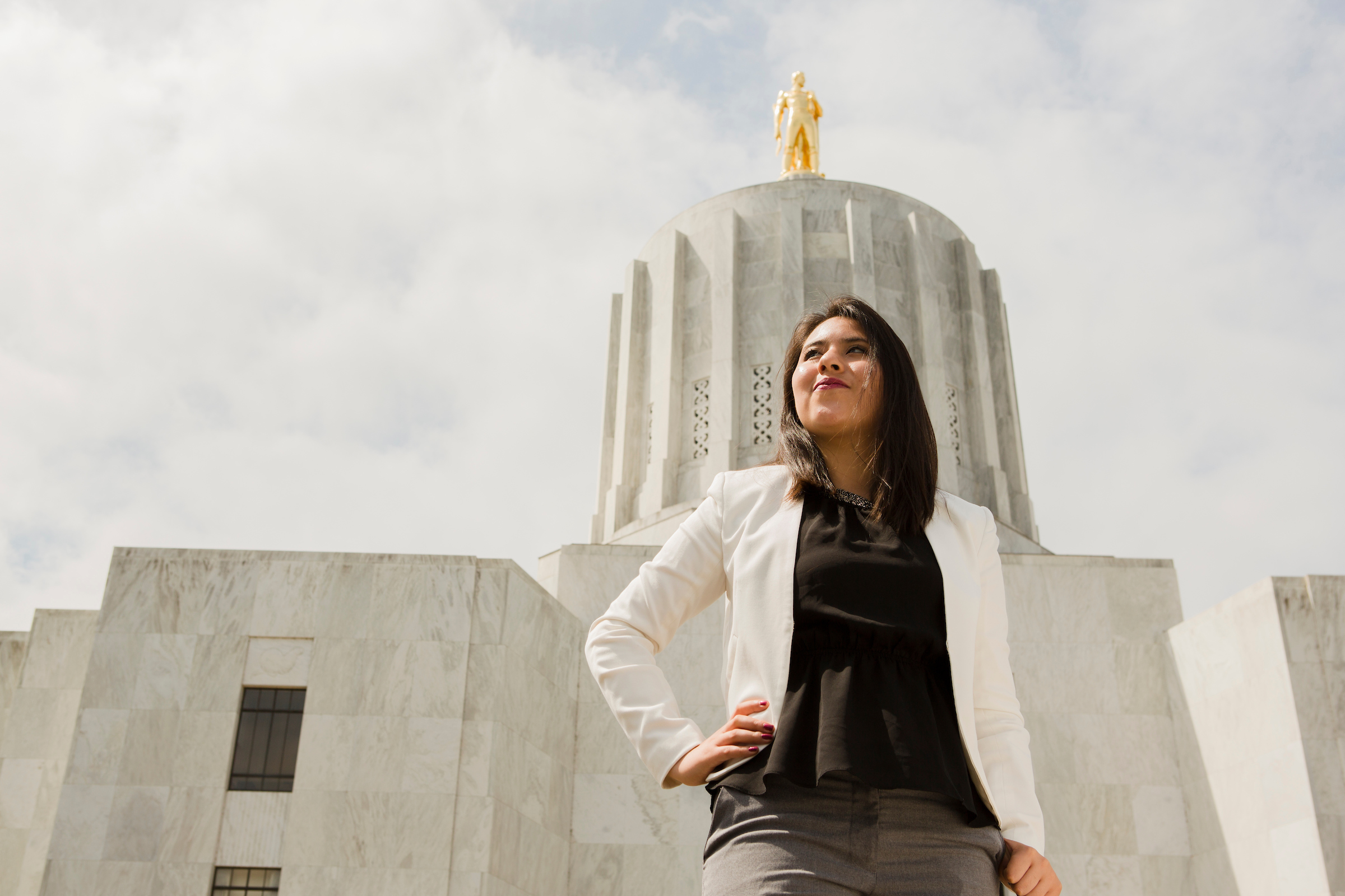 Woman standing on the steps of the Oregon state capitol building