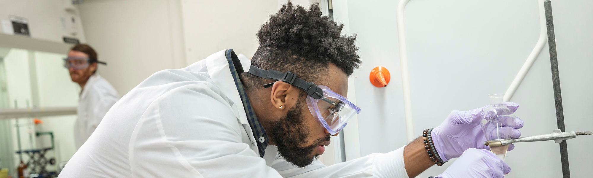 PSU community health student working in a lab