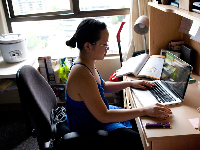 Student on laptop in dorm room