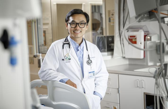 An OHSU doctor standing in a medical room.
