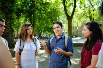 A group of students having a discussion outside